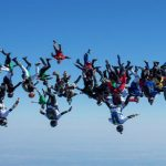 Watch 57 skydivers – Party flying through the sky